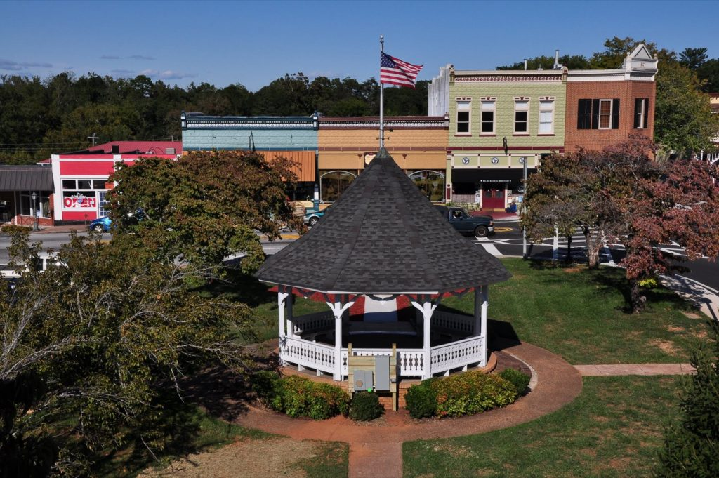 Gazebo in town square with flag on roof